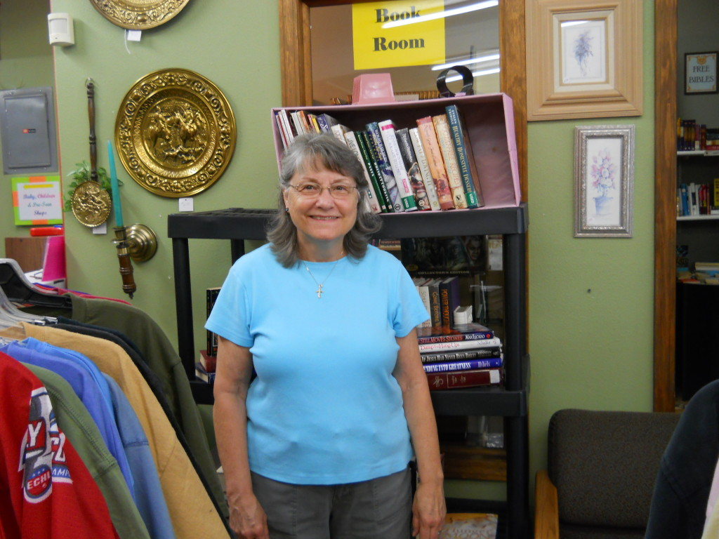 Kathy has been volunteering at the Community Center since it opened in 2013.  She continues to come in every week to lovingly put our linens together, decorate our store with her creative touch, and help customers at the register.  She always seems to have something homemade or from her garden to bring us when she comes in.  She is such a light and blessing to this ministry!""