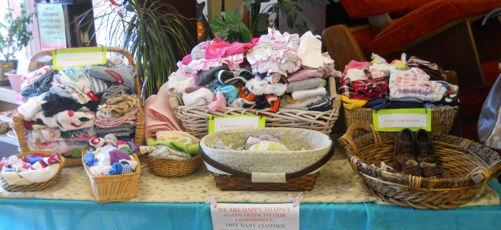 This display of free baby clothes has been carefully and lovingly sorted and prepared by our Work Skills Staff!